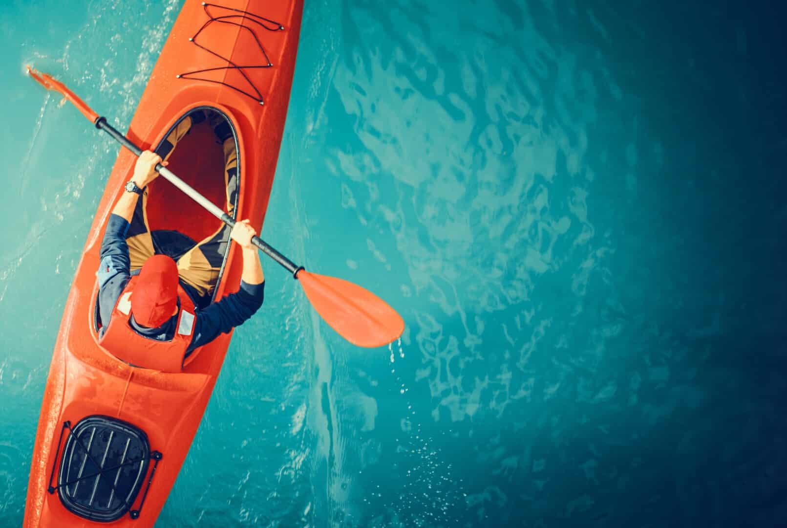 Kayaker,Lake,Tour,Aerial,Photo.,Red,Kayak,And,Caucasian,Paddling