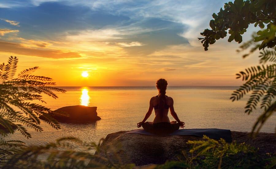 Serenity,And,Yoga,Practicing,At,Sunset,meditation