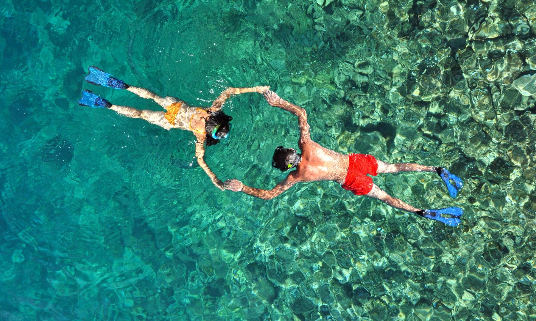 Romantic couple snorkeling in Phi Phi island, Thailand